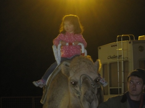 Violet's riding a camel all by herself!